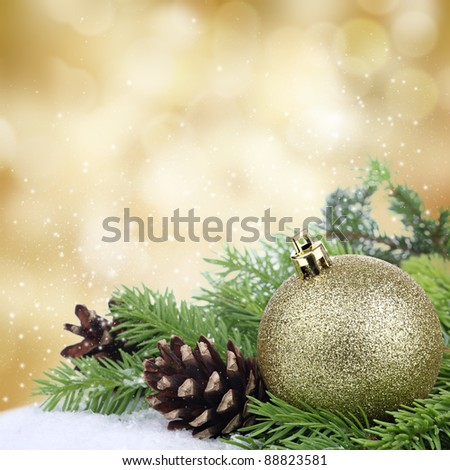 Christmas bauble border on golden background