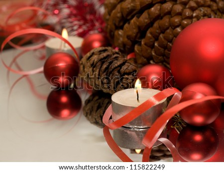 Christmas Bauble, candles and ribbon - stock photo