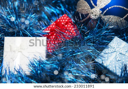 Christmas bauble, gifts and blue  Metallic Garland - stock photo