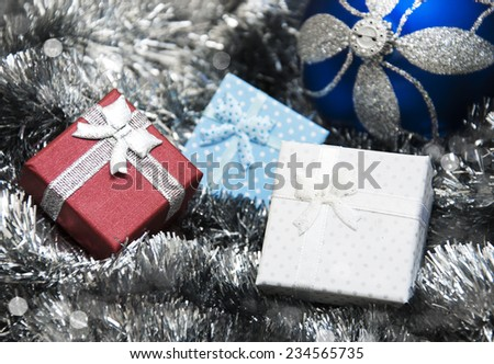 Christmas bauble, gifts and silver  Metallic Garland - stock photo