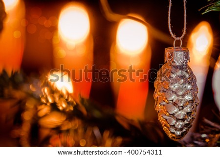Christmas bauble in shape of a pinecone on a tree - stock photo