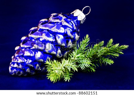 Christmas bauble isolated on blue