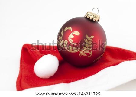 Christmas bauble on a Santa's hat - stock photo