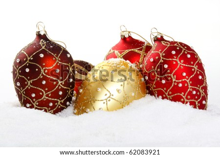 Christmas bauble on white snow background  - close up - stock photo