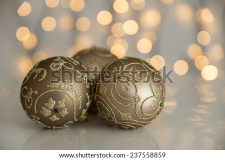 Christmas bauble with christmas tree lights on white background. - stock photo
