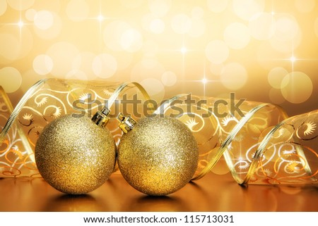 Christmas bauble with curled ribbon on holiday background