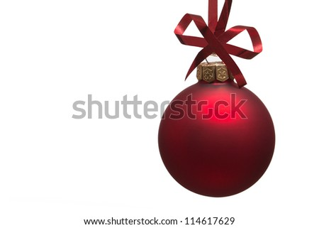 Christmas bauble with curly ribbon isolated on white - stock photo