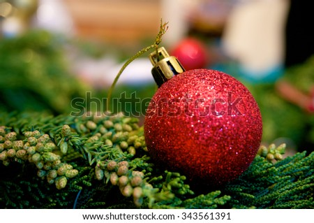 Christmas bauble with on christmas background - stock photo
