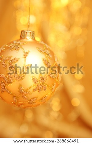 Christmas bauble with out of focus lights in background