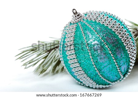Christmas bauble with pine branch on white background - stock photo