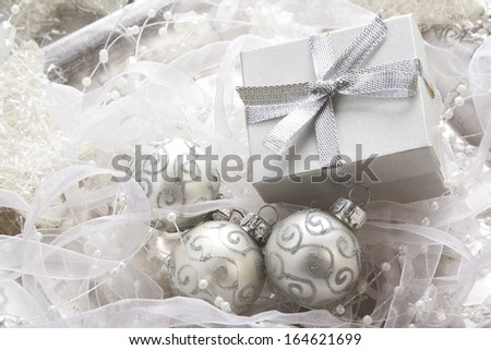 Christmas baubles and gift box, background  - stock photo