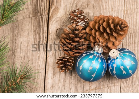 Christmas baubles and pine cones top view - stock photo