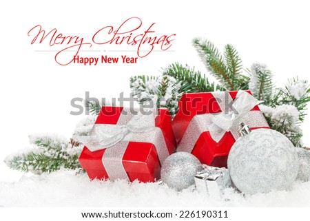 Christmas baubles and red gift boxes with snow fir tree. Isolated on white background with copy space - stock photo