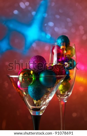 christmas baubles in wineglasses. - stock photo
