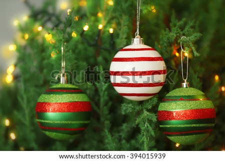 Christmas baubles on a fir tree branch - stock photo