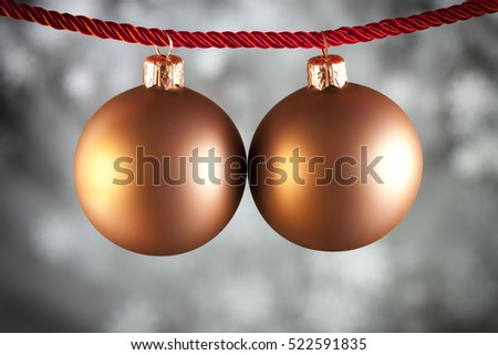 Christmas baubles on black and white background