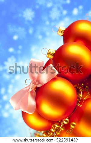 Christmas baubles on blue abstract background