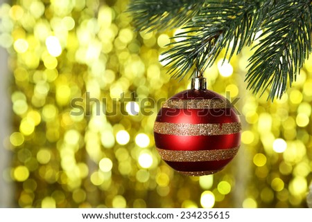 Christmas baubles on christmas tree on lights background - stock photo
