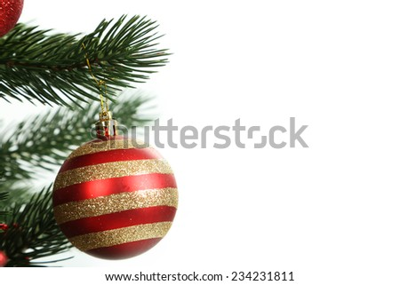 Christmas baubles on christmas tree on white background - stock photo