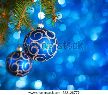 Christmas Baubles on light blue background with sparkles . - stock photo