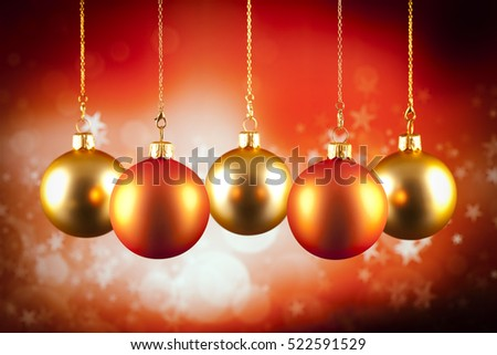 Christmas baubles on red background