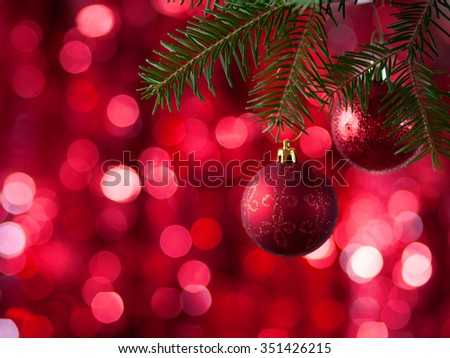 Christmas Baubles on red  background with sparkles . - stock photo