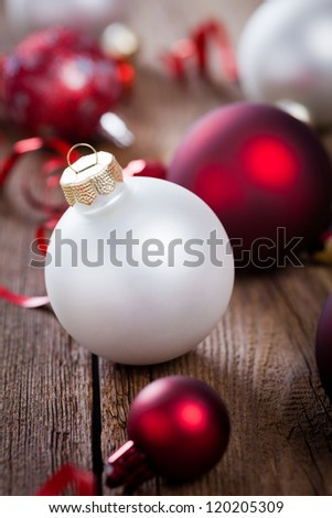 christmas baubles on weathered wooden board - stock photo
