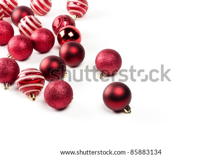 Christmas baubles over a white background - stock photo