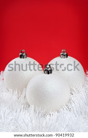 Christmas baubles over red background