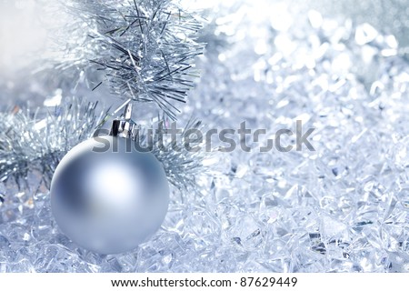 christmas baubles silver on winter ice with star symbol shapes
