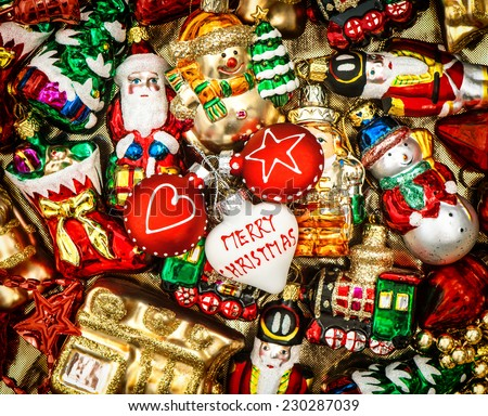 christmas baubles, toys and ornaments. vintage decorations. retro style toned picture - stock photo