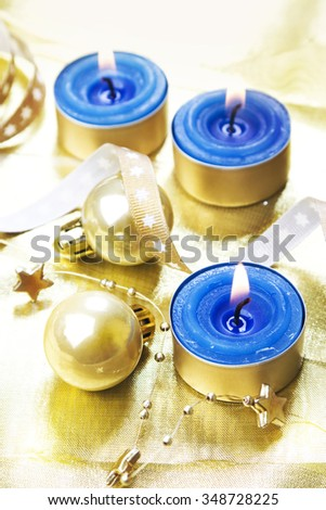 Christmas baubles with candles. - stock photo