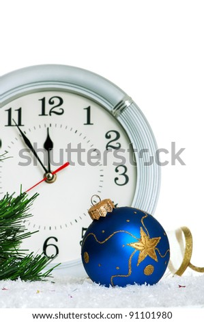 Christmas baubles with clock on white background