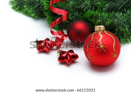 Christmas baubles with curly ribbon on christmas tree