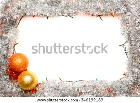 Christmas baubles with lights and silver tinsel frame on white background - stock photo