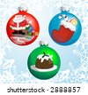 Christmas baubles with pictures of Santa Claus, Christmas stocking, and Christmas pudding reflected or painted on them!. Raster version - stock photo