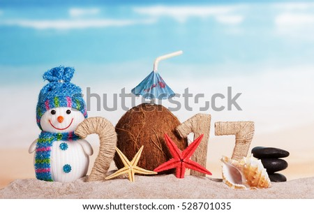 Christmas beach with the inscription 2017, snowman, coconut and starfish