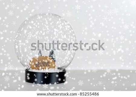 Christmas believe snow globe - stock photo