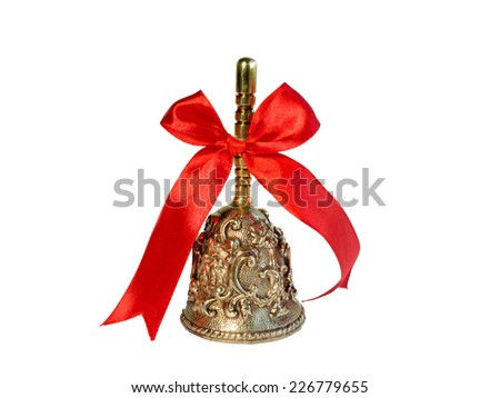 Christmas bell decorated on red ribbon - stock photo