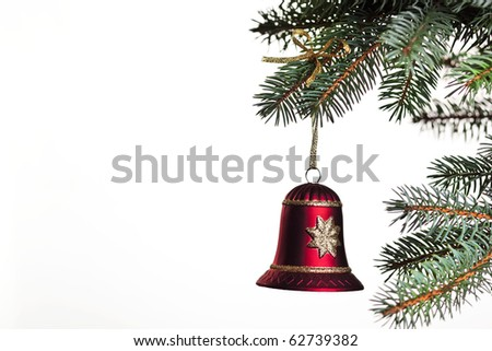 Christmas bell hanging on a christmas tree, on white background isolated, a lot of copyspace available - stock photo
