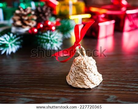Christmas bell next to the christmas tree - stock photo