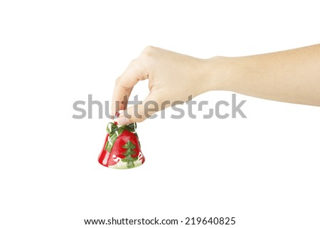 Christmas bell toy in hand - stock photo