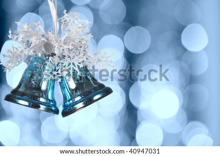 Christmas bells against defocused background with shallow depth of field and copyspace - stock photo