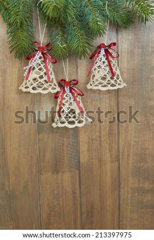 Christmas bells on wooden background - stock photo