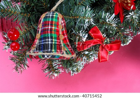 Christmas bells with pink background - stock photo