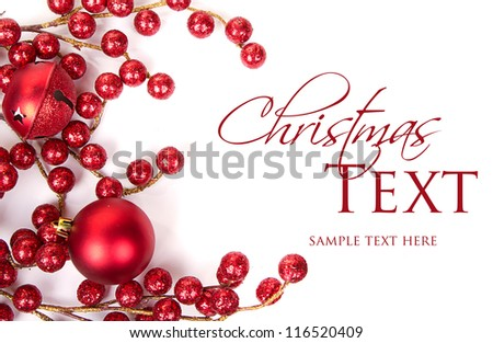 Christmas berries and ornaments on white background - stock photo