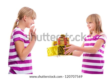 Christmas/Birthday gift -Girl giving gifts to another girl isolated on white background - stock photo
