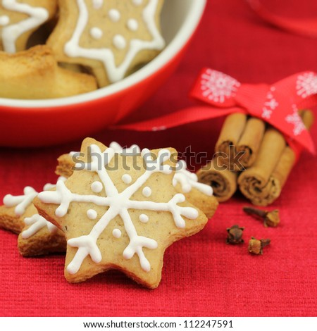 Christmas biscuits. Cookies decorated with royal frosting and cinnamon stick and cloves at the background - stock photo