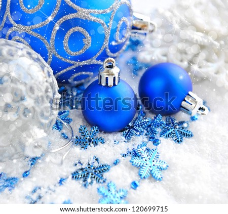 Christmas blue and silver decorations on snow - stock photo