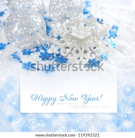 Christmas blue and silver decorations on snow on a background a postal with sample text